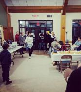Rabbi Eli gives the blessing before dinner.
